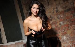 Charley teasing in her black top and tight black leggings