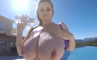 Maria Body is giving herself an oil massage under the sun