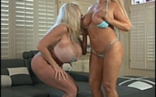 Two big boobed blonde MILF's fuck each others shaved pussies with big toys.
