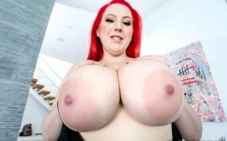 Busty redhead Kamille Amora seduces in black
