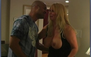 Blonde MILF with huge melons gets banged hard by black stud.
