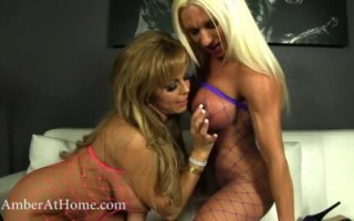 Amber Lynn Bach and Ashlee Chambers dress up in fishnet and have hot lesbian sex.