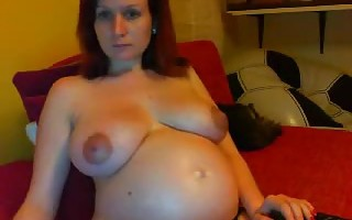 Webcam show with pregnant beauty showing off her big boobs