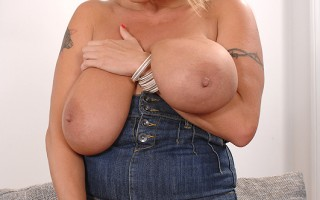 Busty babe Laura M. masturbating her tight puss with a dildo