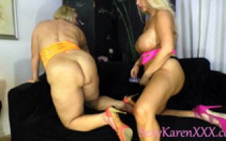 Two blonde MILF's fuck each other with flopping big natural titties wearing a strap on.