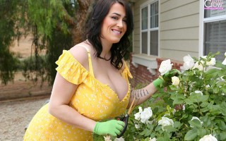 Leanne Crow gardening in yellow summer dress