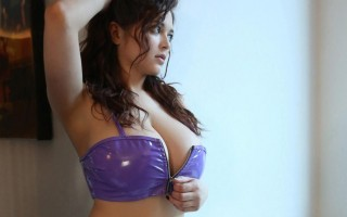 Tessa Fowler in purple vinyl lingerie