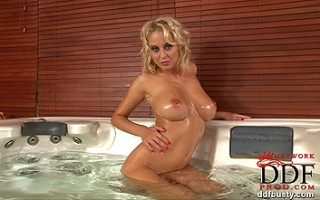 Busty blonde babe Mandy Dee's awesome bathroom striptease